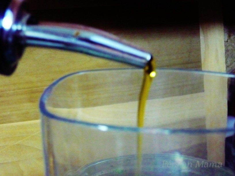 olive oil is added in slow stream through the feeding shoot