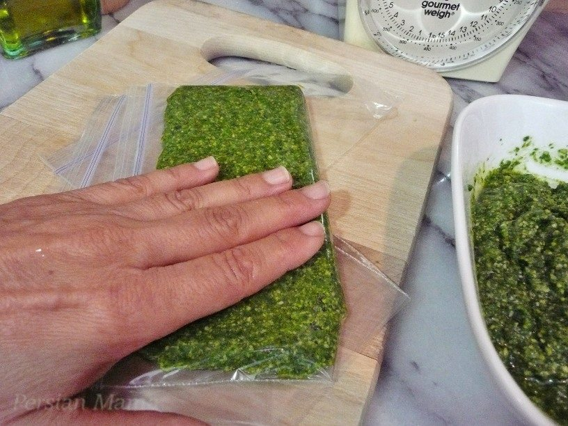 gently press and level the pesto inside the baggie