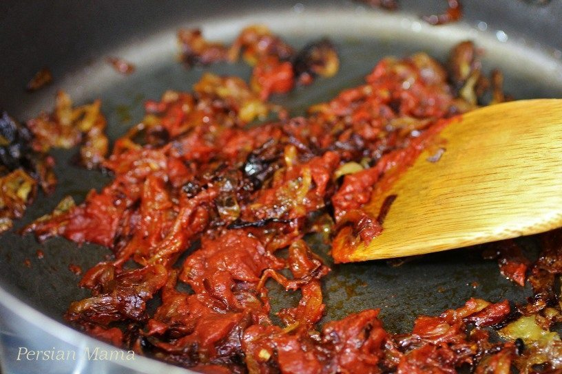 Saute fried onions with tomato paste