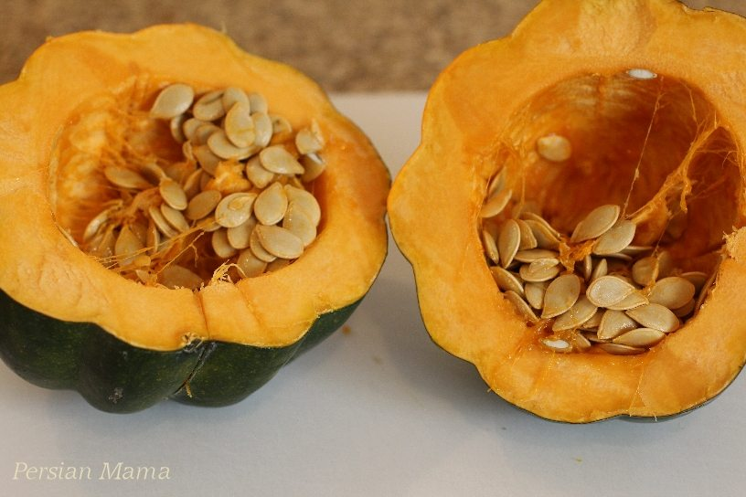 acorn squash is cut in half to expose the seeds