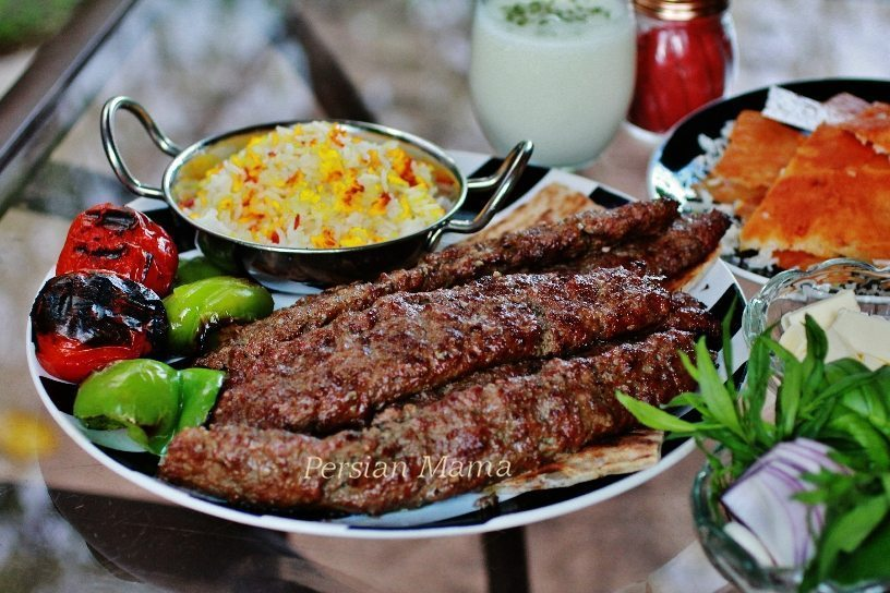 Kabob Koobideh and grilled vegetables with doogh and sumac