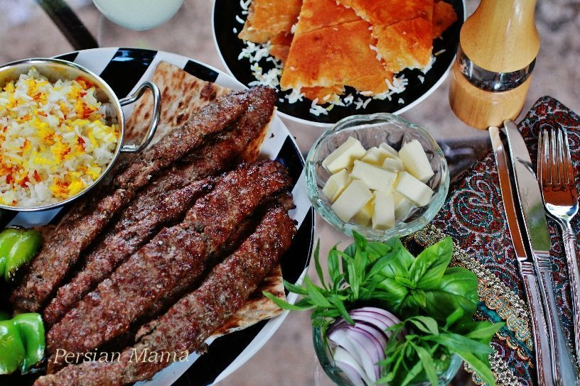 Kabob Koobideh with lavash tahdig and butter for rice and herbs