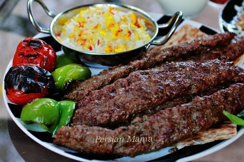 Kabob Koobideh over sangak with grilled veggies and saffron rice