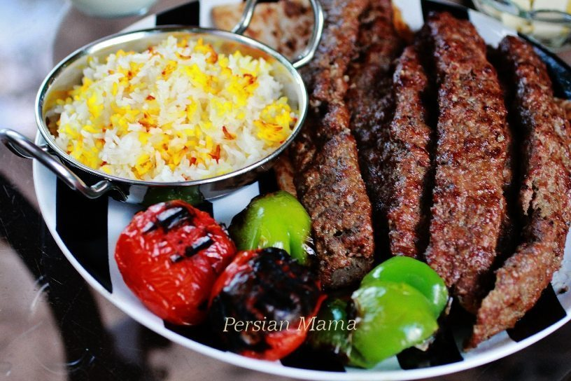 Kabob Koobideh with saffron rice and grilled tomatoes