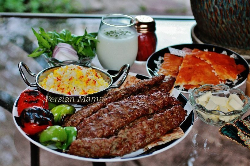 Traditional Kabob Koobideh with doogh sumac and saffron rice tahdig