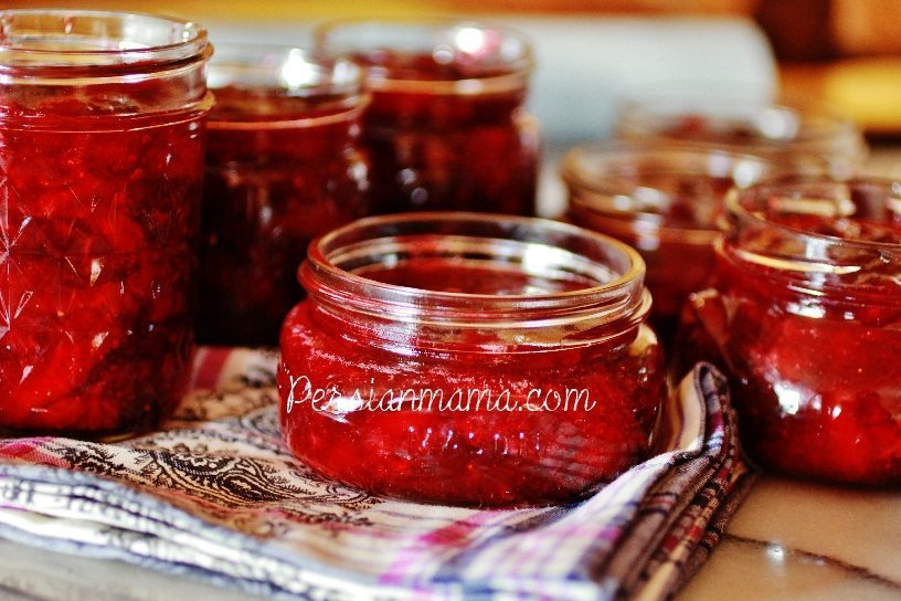filled jars of strawberry cranberry holiday jam