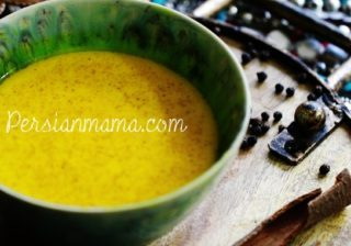 turmeric milk with turmeric cinnamon bark and peppercorns